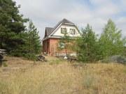 Дом с видом на сосновый лес.